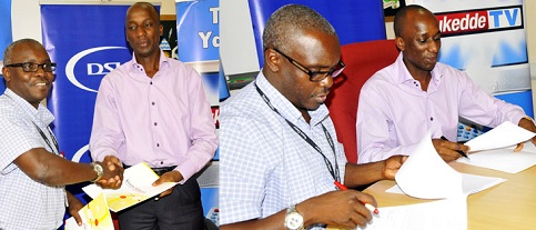 Vision Group's Robert Kabushenga(L) and the General Manager of MultiChoice Uganda Charles Hamya  after putting pen to paper