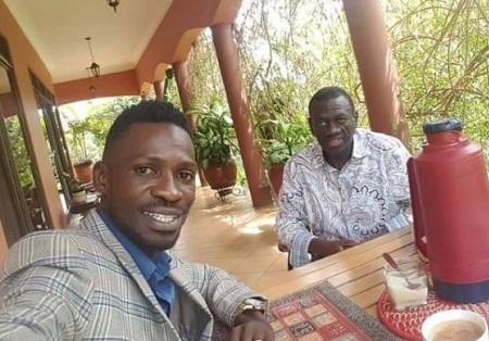 Bobi Wine takes a selfie of him and Kizza Besigye