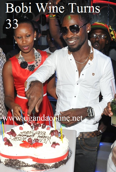 Bobi Wine and Barbie cutting the birthday cake