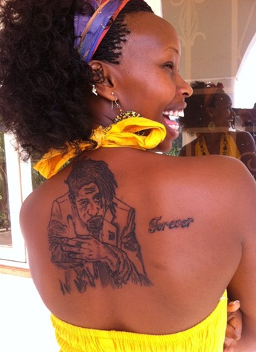 Barbie displaying Bobi Wine's tattoo on her back