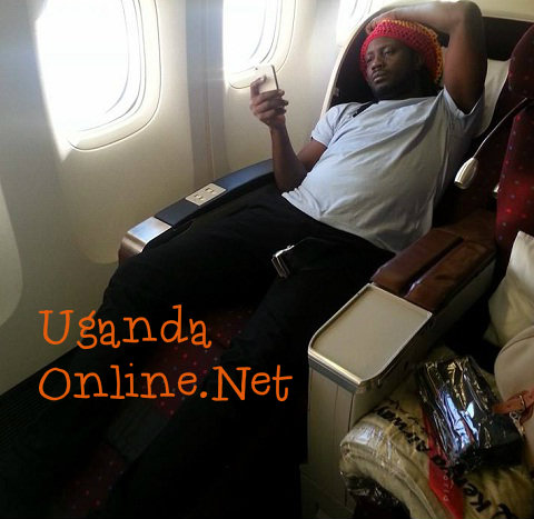 Bebe Cool flying Business Class aboard Kenyan Airways