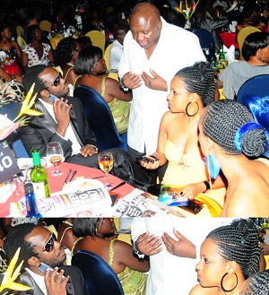 Bebe Cool chats with a friend as Zuena looks on
