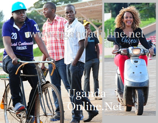 Zari's husband on a bicycle as Zari cruises an old scooty