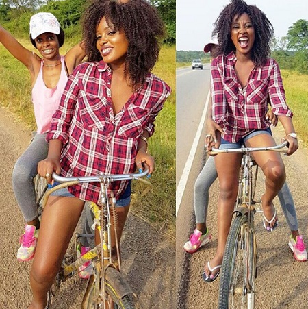 LEILA Kayondo riding a bicycle as Hellen cheers her all the way