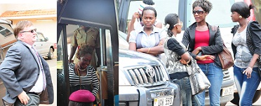 David looks at Black disembarking from the Prison's bus as some of the Black Gal brigade members look on