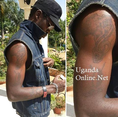Bobi Wine showing off his tats