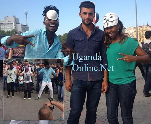 Bobi Wine and Barbie pose with a 'fan' at Taksim Square