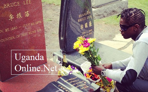 Jose Chameleone at Bruce Lee's grave site in Seattle