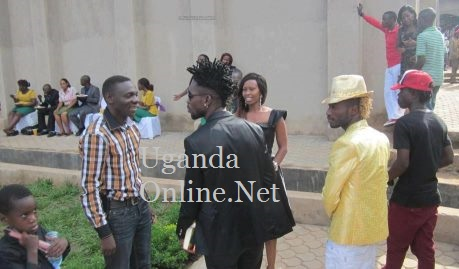 Pastor Bugembe and Bobi Wine chatting outside the church