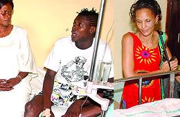 Chameleone talking to the mum as his wife Daniella looks on at Nsambya Hospital yesterday