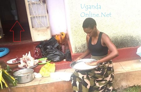 Cindy sorting out rice ahead of Muyiisa's visit to her parents. Don't mind about the background.