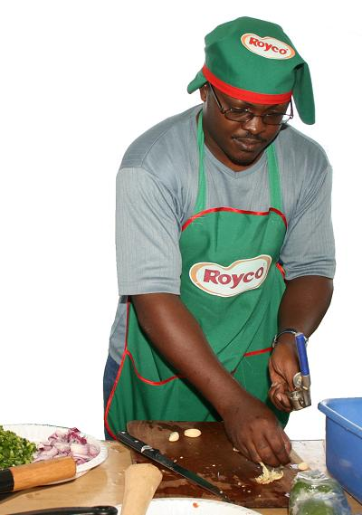 Mark Kaheru trying out his cooking skills
