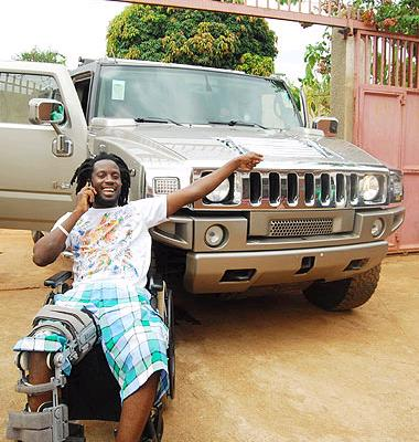 Munene munene besides his hummer