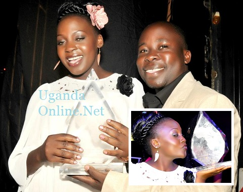 Iryn Namubiru and her manager Thadeus Mubiru with her PAM Awards Artiste of the year trophy