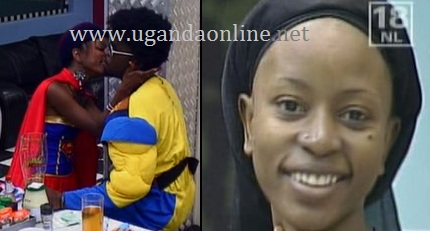 Uganda's Jannette kissing Malawi's Wati in the Big Brother Downville house
