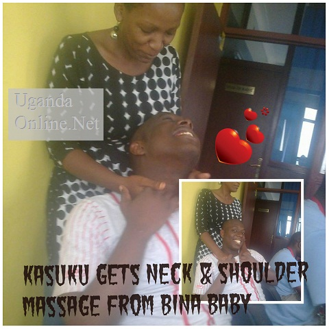 Bina Baby offering Kasuku a neck massage