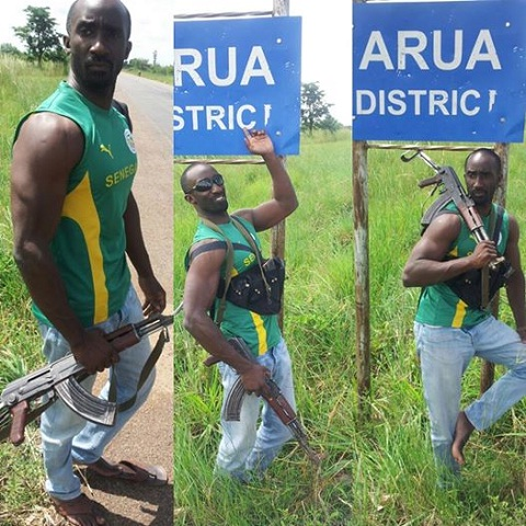 Farouk Sempala strikes a pose with his AK47 IN Arua District