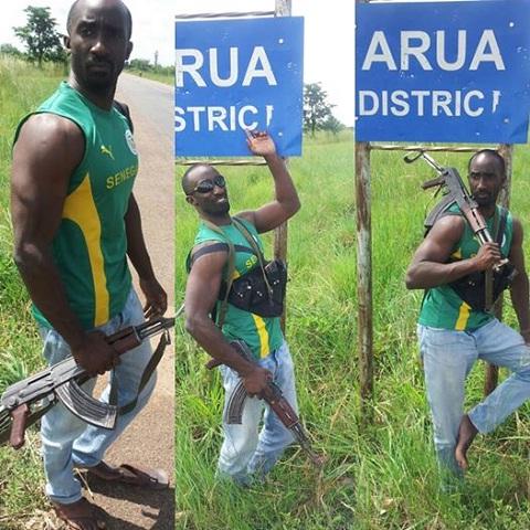 Farouk Sempala strikes a pose with his AK47 IN Arua District