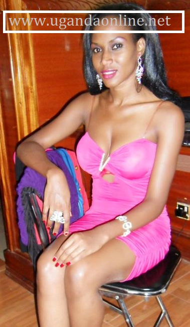 Miss Uganda 2011-2012 Sylva Namutebi in a short pink dress